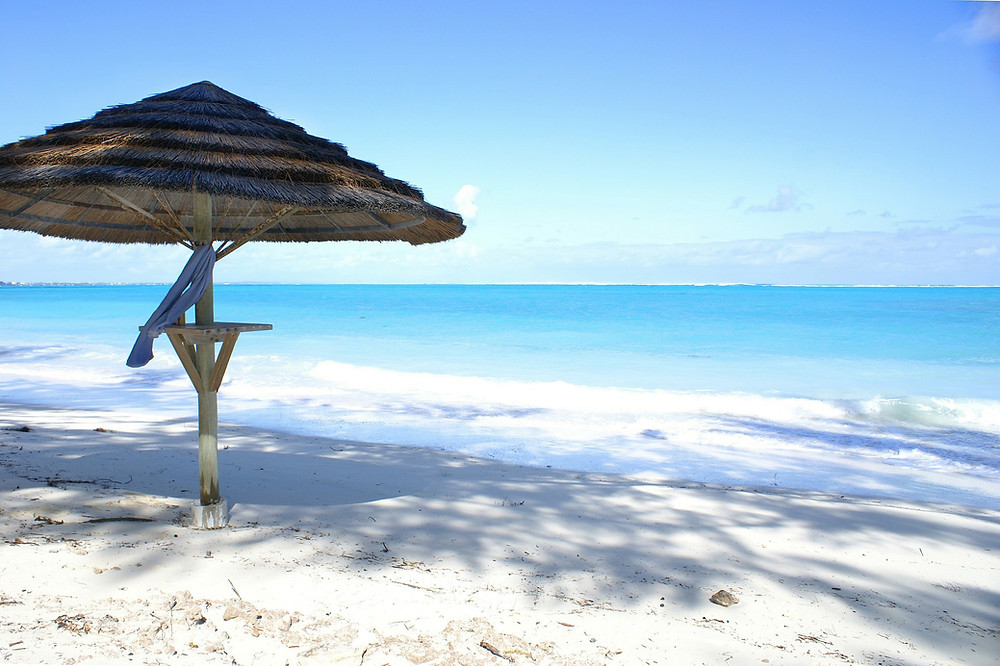 shaded white sand beach and turquoise waters of Turks & Caicos