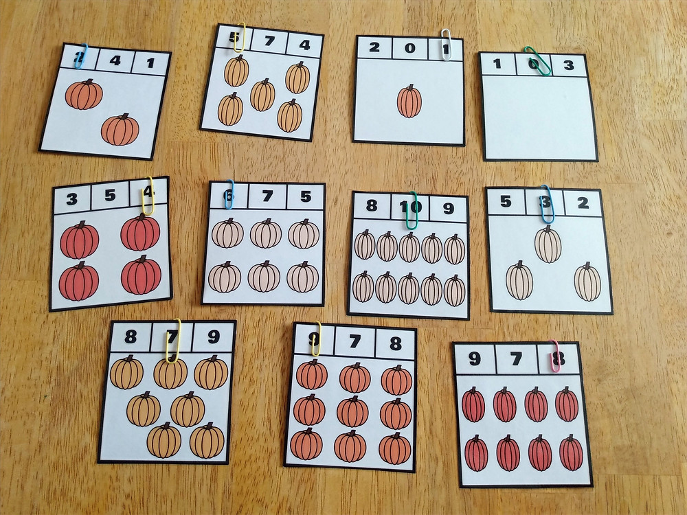 Pumpkin themed counting clip cards using paper clips