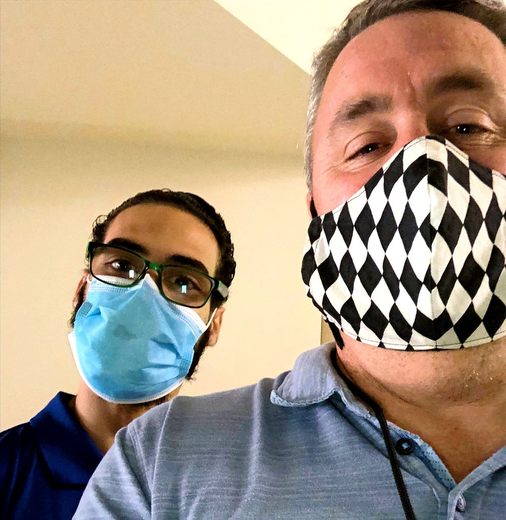 Deven with his TMI Job Coach Andy Palasciano wearing masks at Balboa Naval Hospital