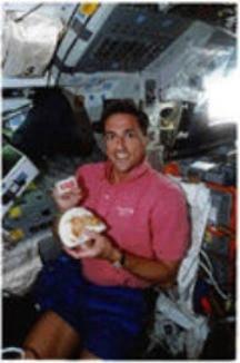 Don Thomas (native of Ohio) in orbit enjoying Stadium Mustard, especially packaged for use in zero gravity...
