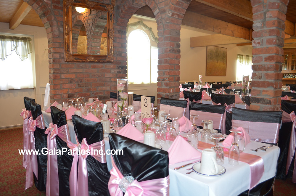 Black satin chair cover with Pink Satin Sash. Pink and black wedding decor