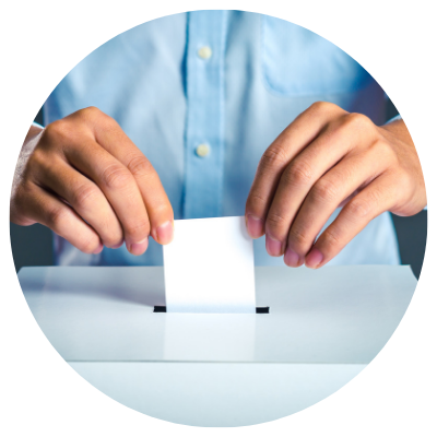 Person dropping their ballot off in a ballot box