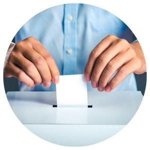 Person dropping their ballot off in a ballot box