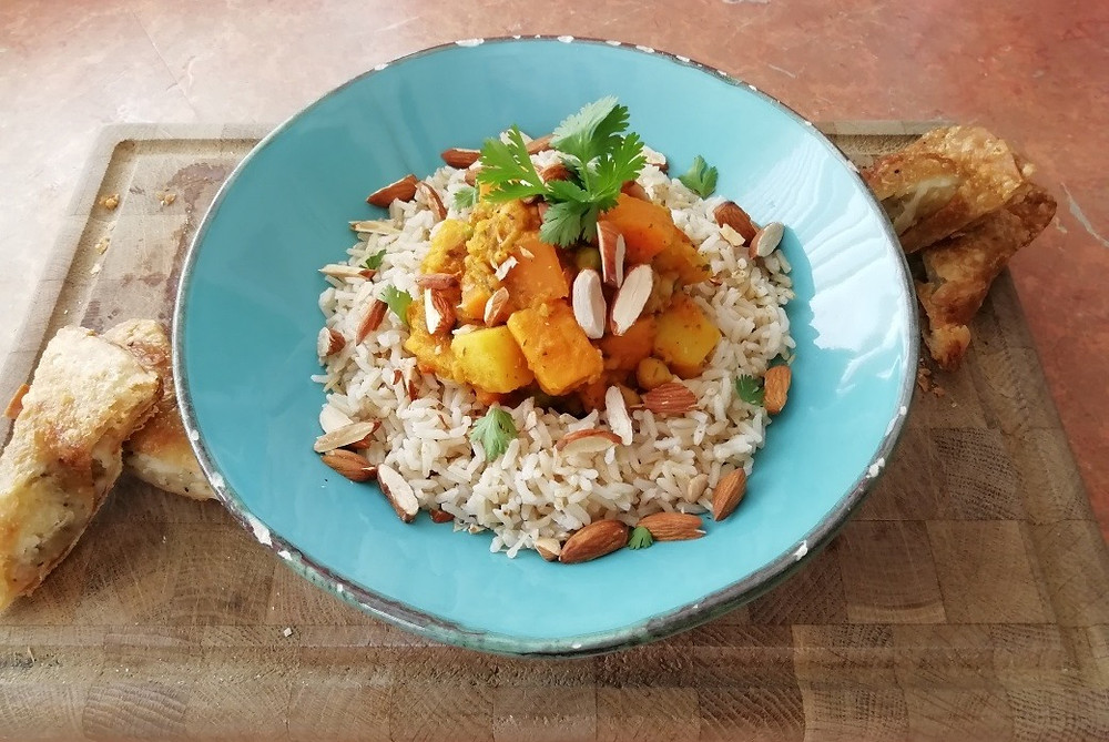 a super healthy sweet potato curry with roasted almonds and brown basmati rice