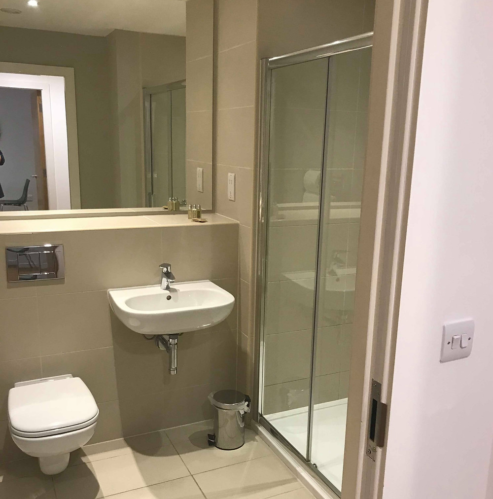 Bathroom and shower inside SACO Apartments Manchester England