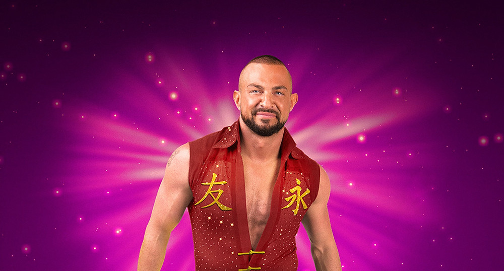 Show of hands for Robin Windsor in Aladdin in St Helens. Pics: company