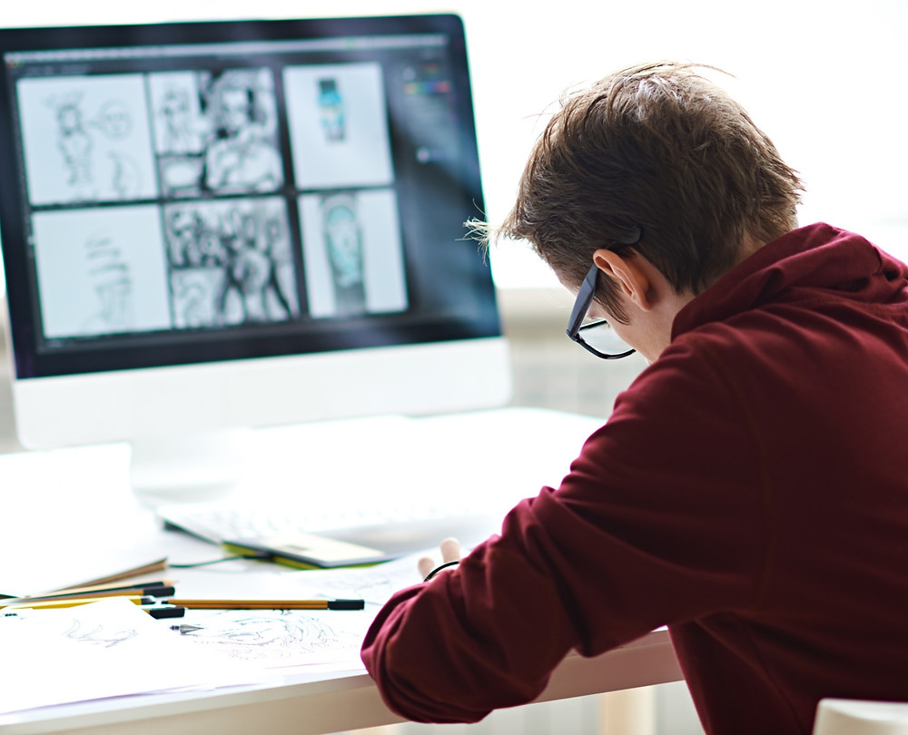 Boy at desk T Level digital media study construction school learning