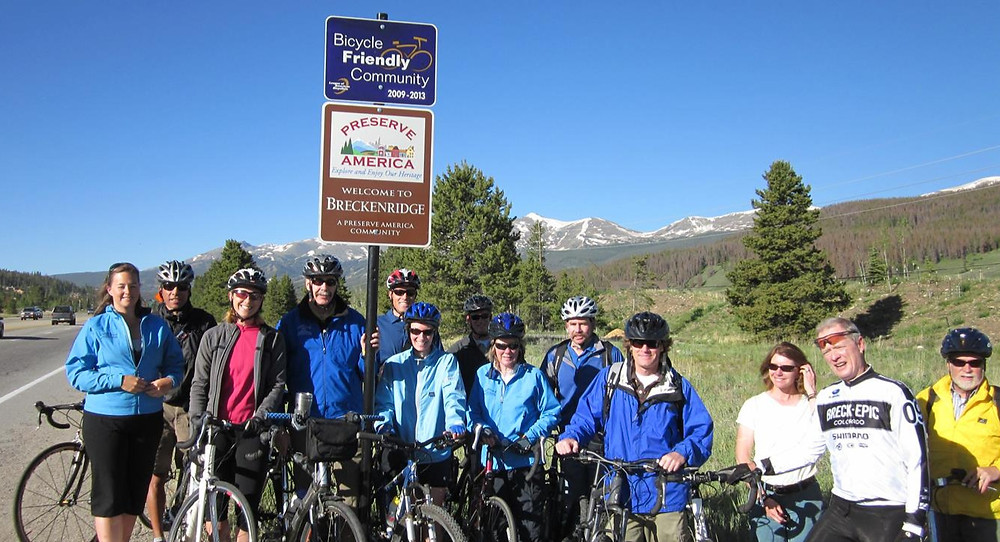 Group poses to receive bicycle friendly award.