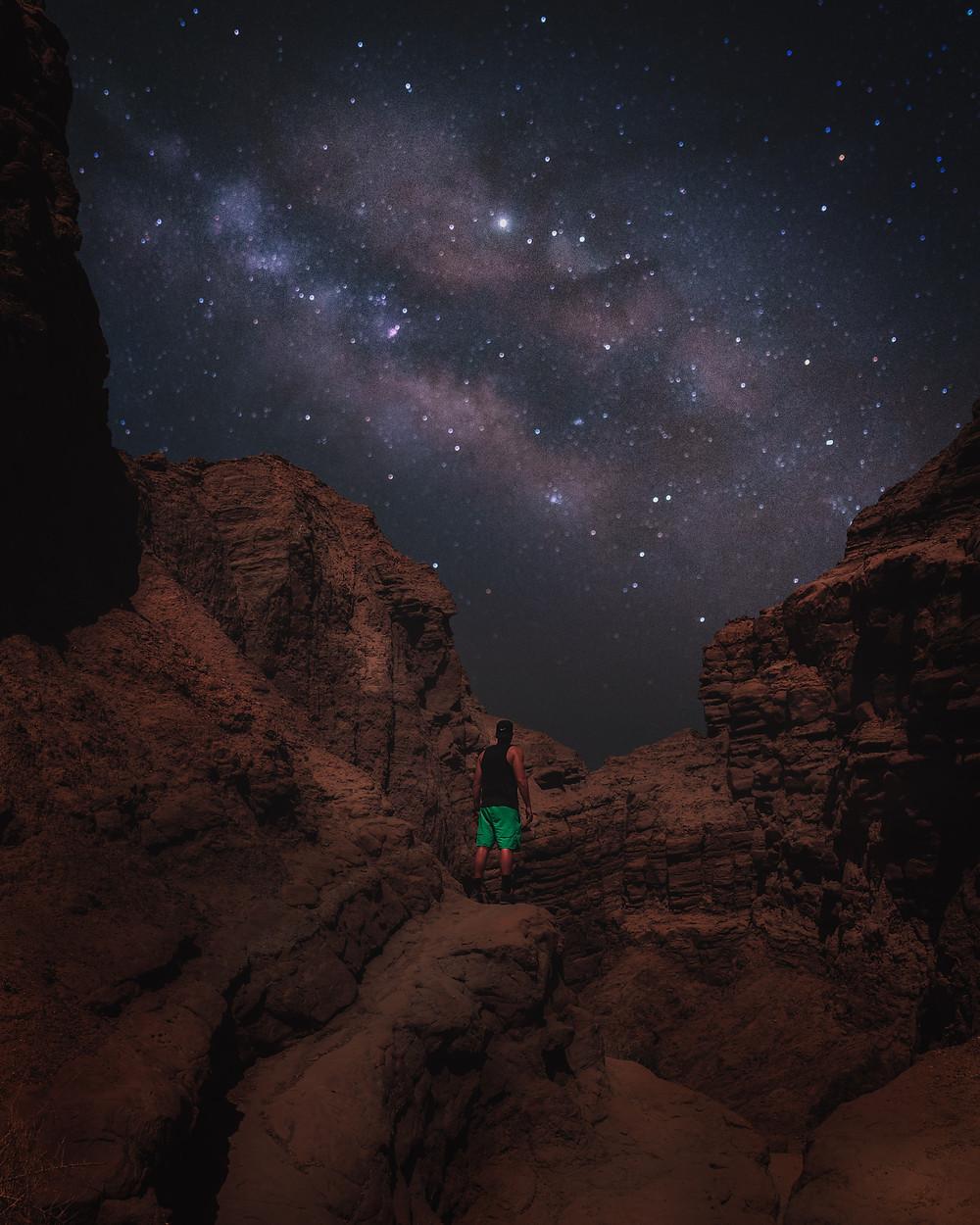 hiking under the Milky Way stars at night