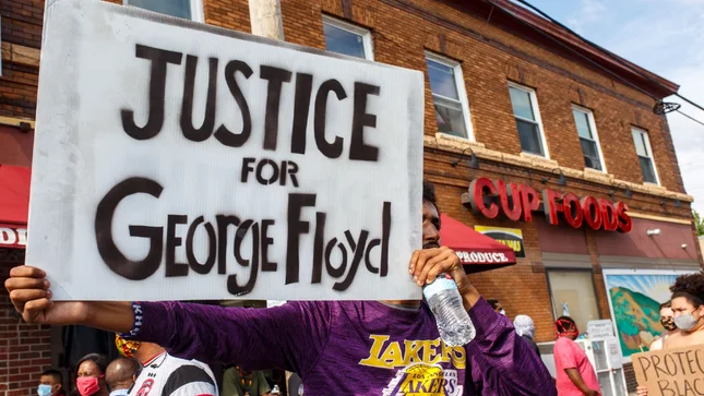 Justice for George Floyd poster being held at protest.
