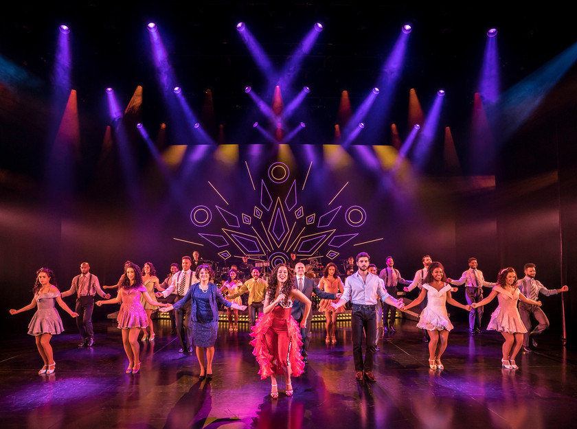 Philippa Stefani as Gloria Estefan and the company of On Your Feet!, Palace Theatre, Manchester