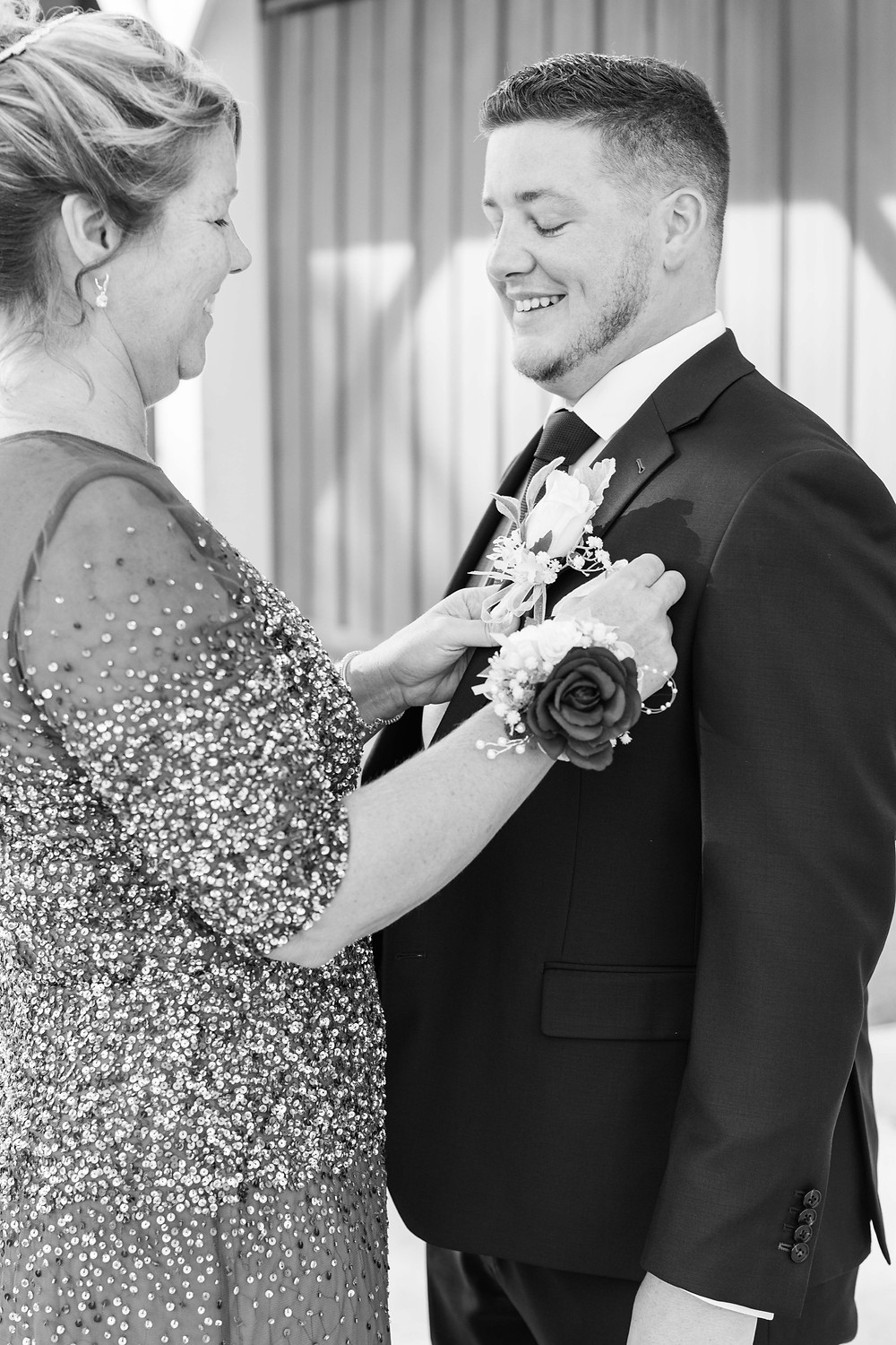 Groom and mom smiling wedding American 1 event center Jackson michigan