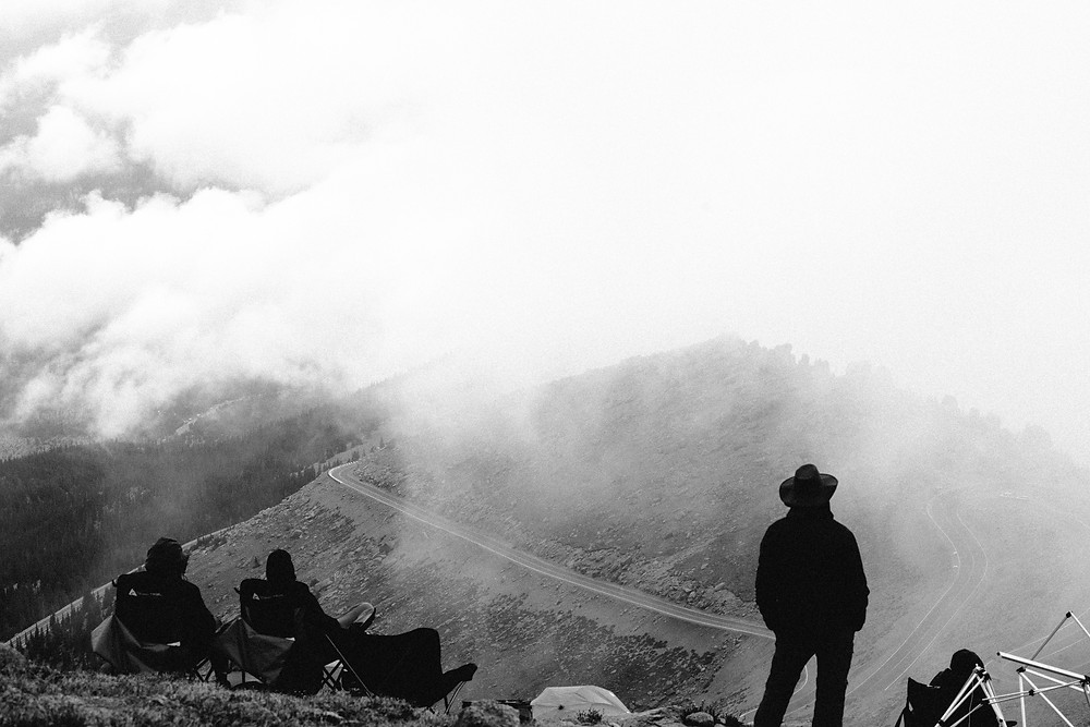People watching the Pikes Peak Hillclimb through the clouds from Devil's Playground, CO