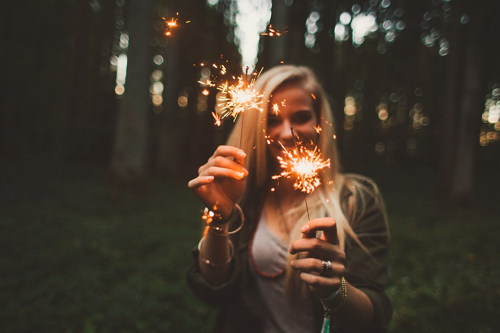 Girl happy sparklers