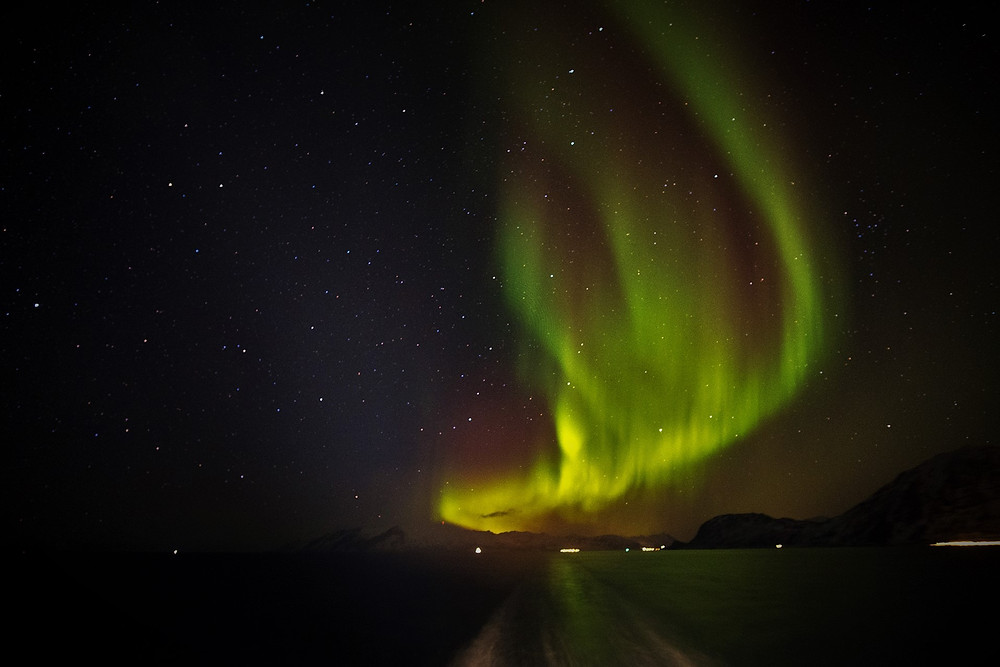 Aurora Borealis or Northern Lights off Norway coast towards Tromso on board the Hurtigruten