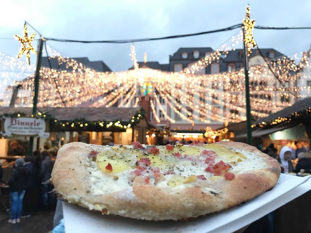Dinnete pizza dish at Mainz Christmas market in Germany