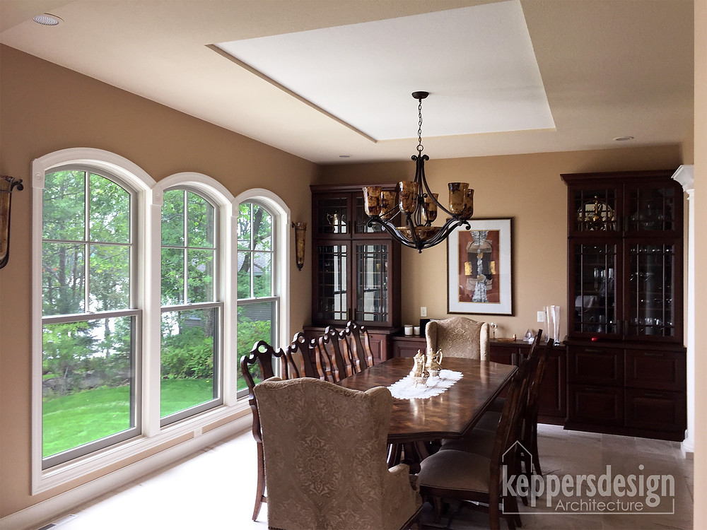 Elegant dining room with arch top double hung windows