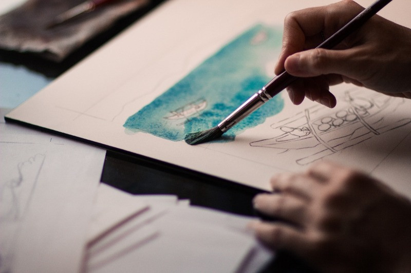 a hand and a brush - creating a watercolour painting