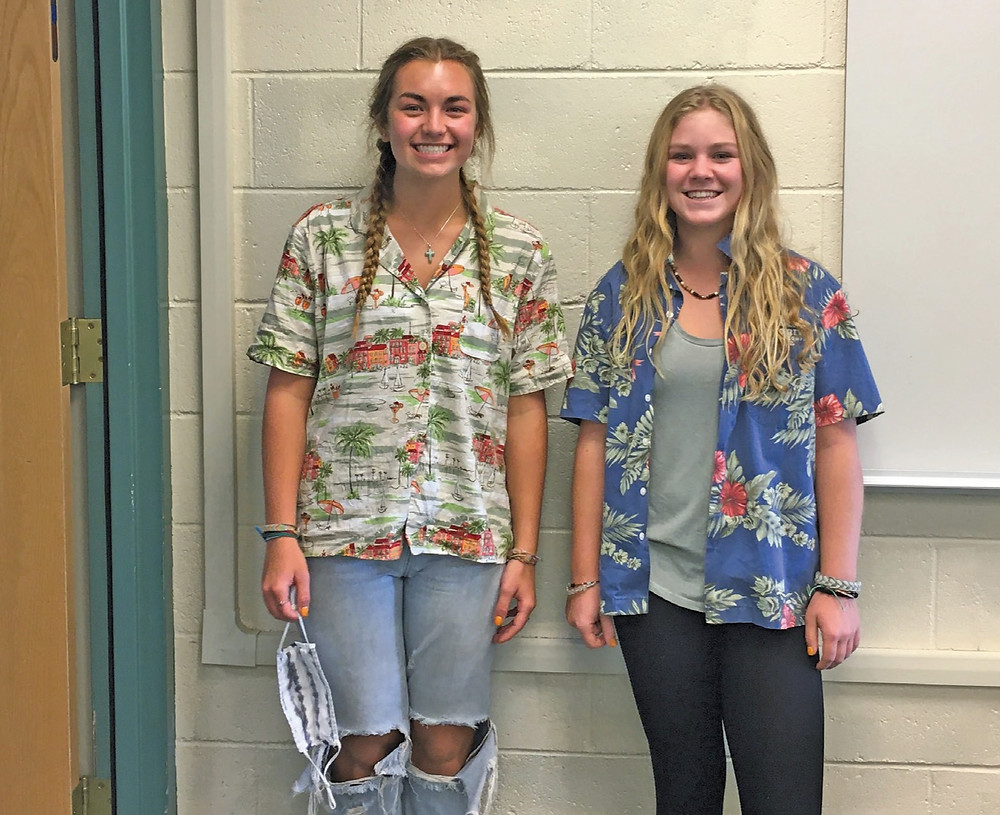 Pinedale High School juniors wear tropical print shirts and stand in front of a classroom