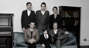 The Walkmen in suits, with a child in the middle