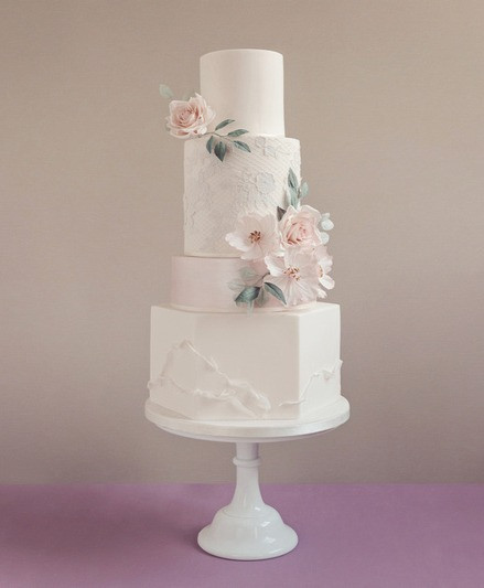 Pink lustre and lace wedding cake