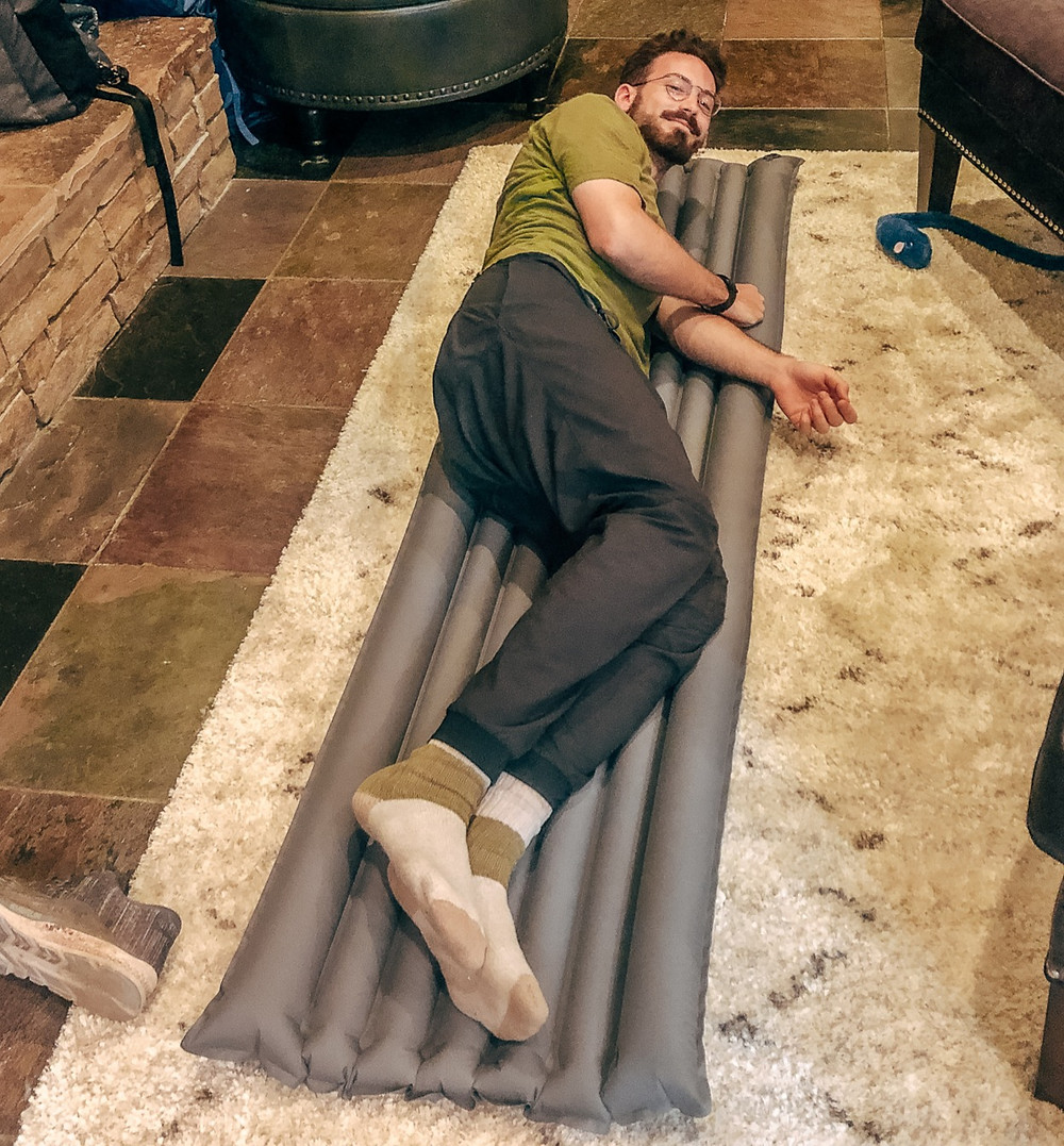 Man laying on blow up mattress