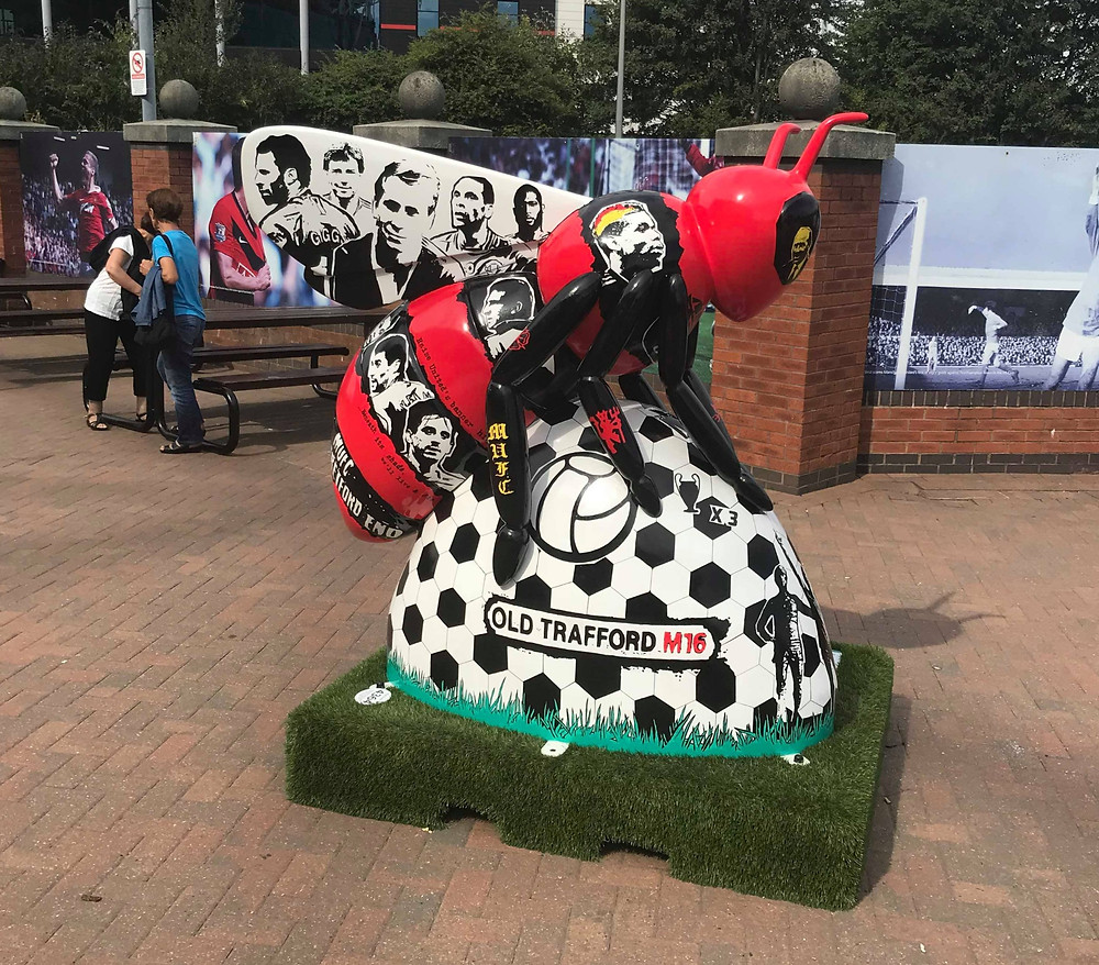 Manchester United bee sculpture outside Old Trafford Manchester, England