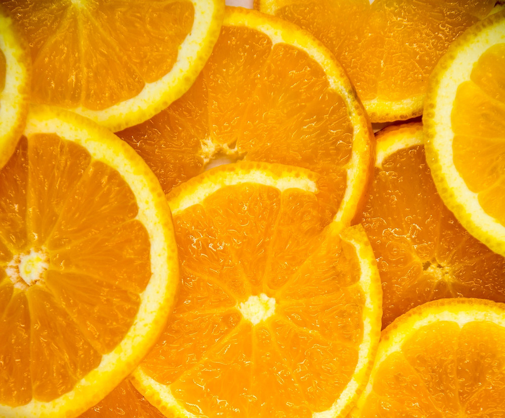 Bright and ripe sliced oranges sitting on top of one another
