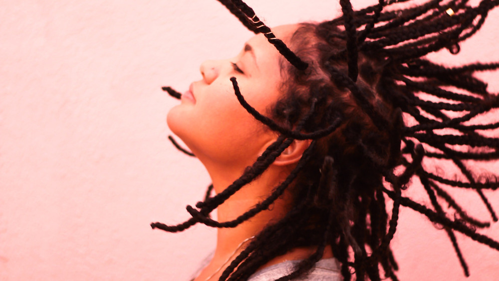 Woman with dreds relaxing