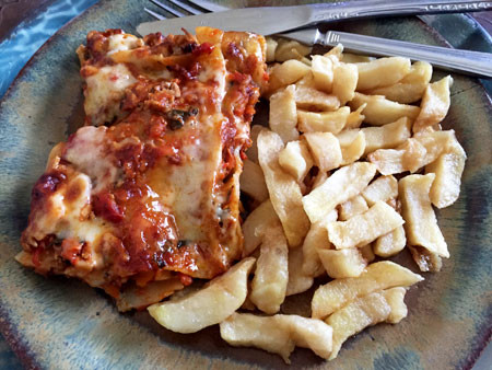 A quick and easy reheat of lasagna and chips for lunch.