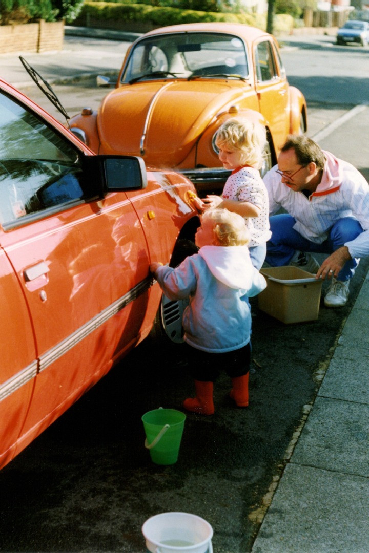 children and dad washing car vintage 90s photo
