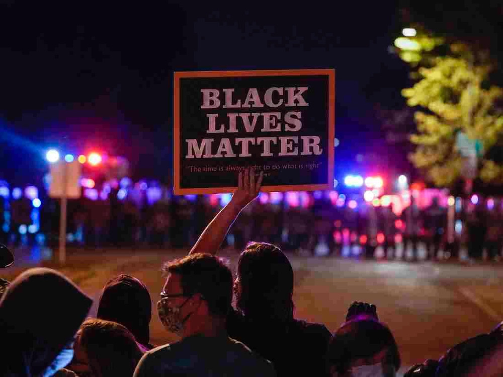 Black Lives Matter sign being held at Black Lives Matter protest.