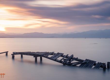 Art and Photos in Peschiera del Garda, Long exposure on Lake Garda , featuring a broken pier.