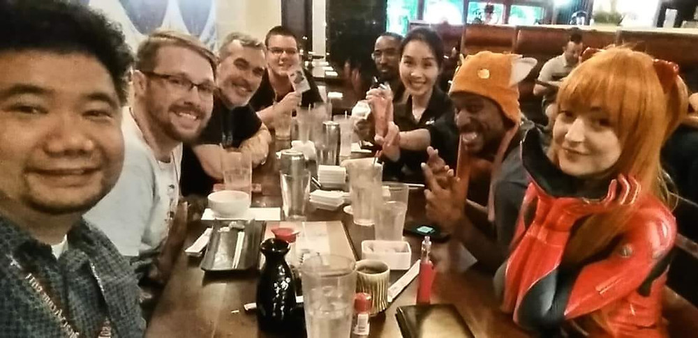 A group of people taking a table selfie with a waitress at Hokkaido Restaurant in Norfolk Virginia