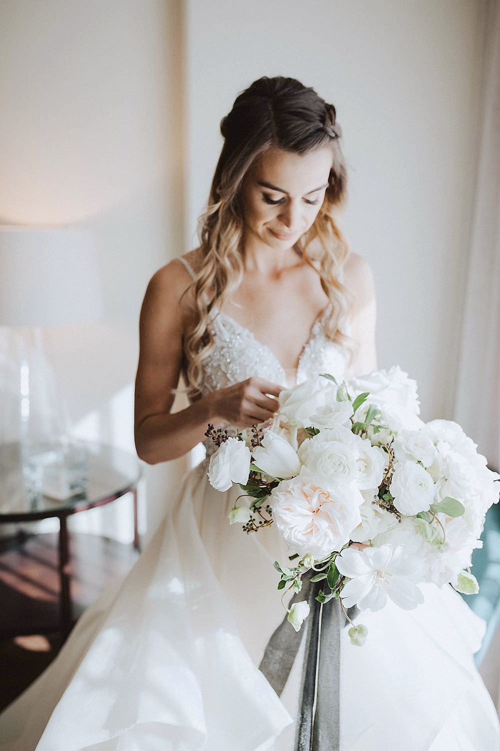 Elegant white, blush and black bouquet for a Black Tie wedding in downtown San Diego, filled with garden roses, tulips, ranunculus and hellebores, made by San Diego Wedding Florist, Le Champagne Projects