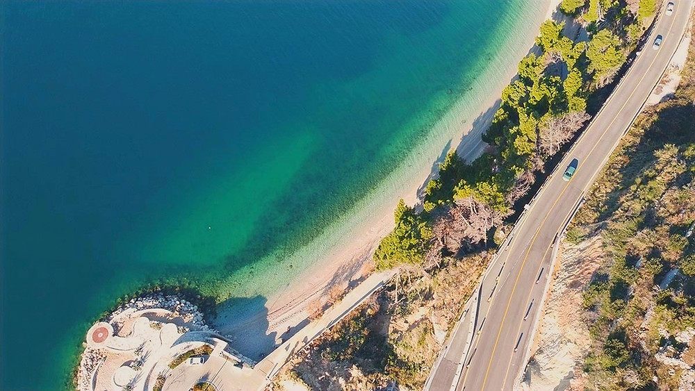 Road trip along magistrala road near Podgora in Croatia with views of sea and beach