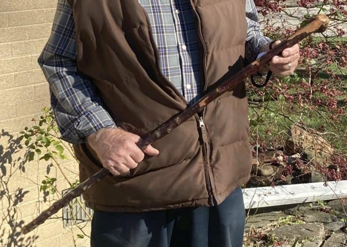 man holding a shillelagh
