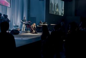 Christian Contemporary Artist Jennifer Jimenez Performs a concert in a church.