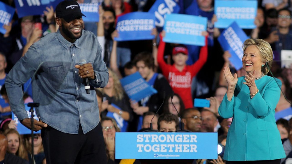 FILE PHOTO: NBA basketball player LeBron James introduces U.S. Democratic presidential nominee Hillary Clinton during a campaign rally in Cleveland, Ohio, U.S., November 6, 2016. REUTERS/Carlos Barria/File Photo