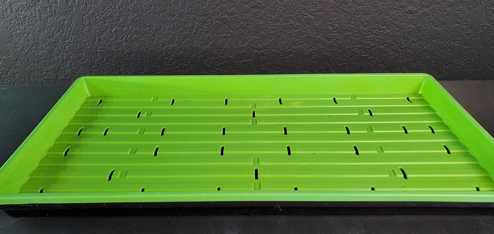Slotted 1020 Microgreen Tray on top of a no holed 1020 Microgreen Tray