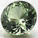 round cut green sapphire on white background