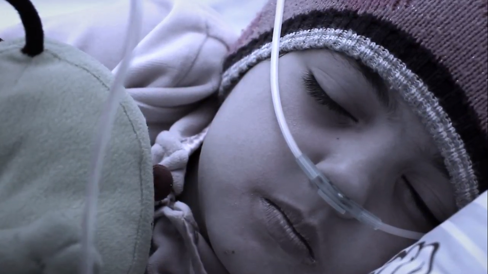 Shot of Nouha Dabani in hospital bed in 'Salima'