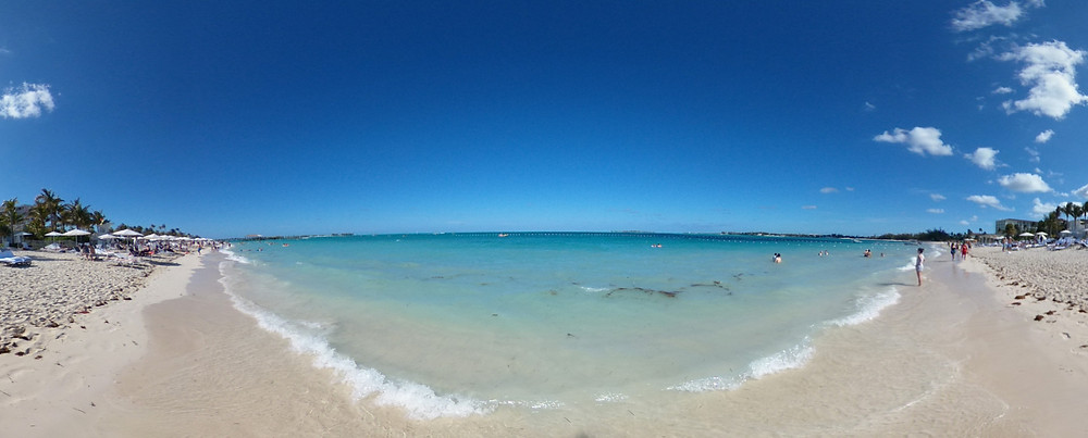 Wide shot of the beautiful turquoise seas of The Bahamas from the beach at the Baha Mar resorts complex near Nassau