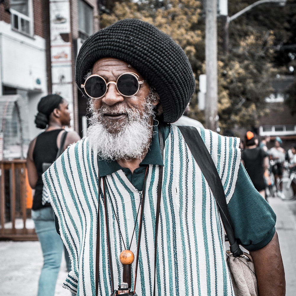Great looking older black gentleman walking down the sidewalk. I snapped a quick candid shot of the man while in Toronto. Edited by Mr Brian James for color with Adobe Lightroom.