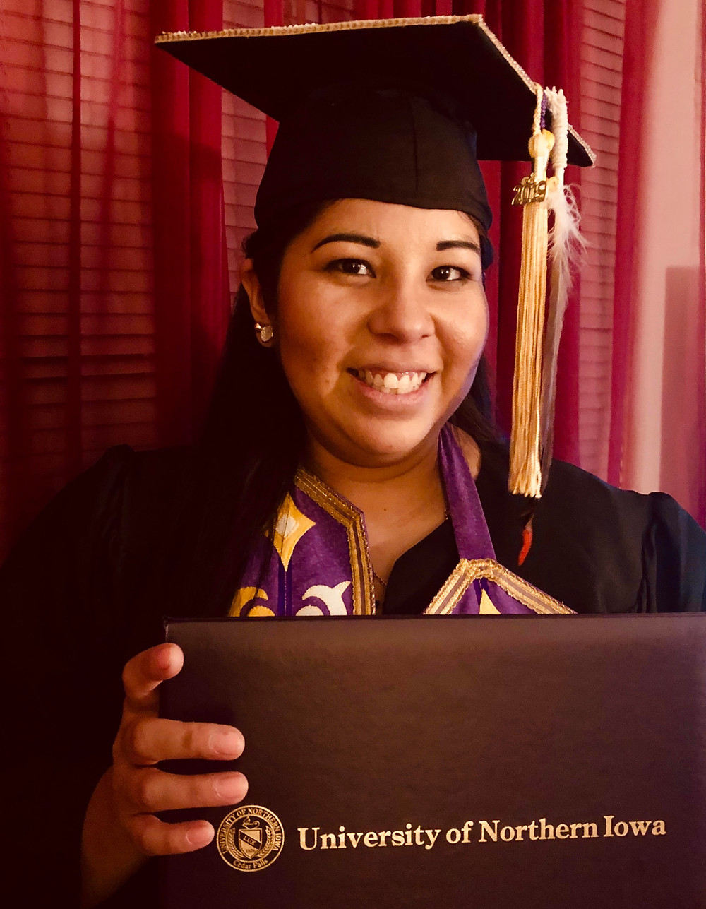 Trisha Caxsep Guwiga Etringer at her graduation ceremony at the University of Northern Iowa in Spring 2019