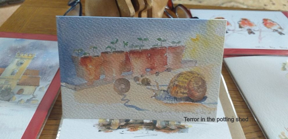 Gardening card featuring snails in the potting shed