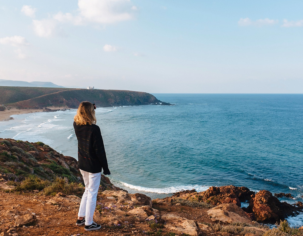 woman-searching -coastal-landscape-meaning