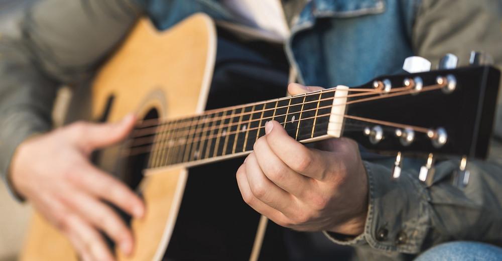 Acoustic guitarist playing easy guitar songs.