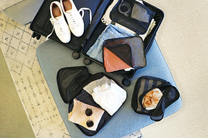 Packing expert shows packing cubes in small luggage