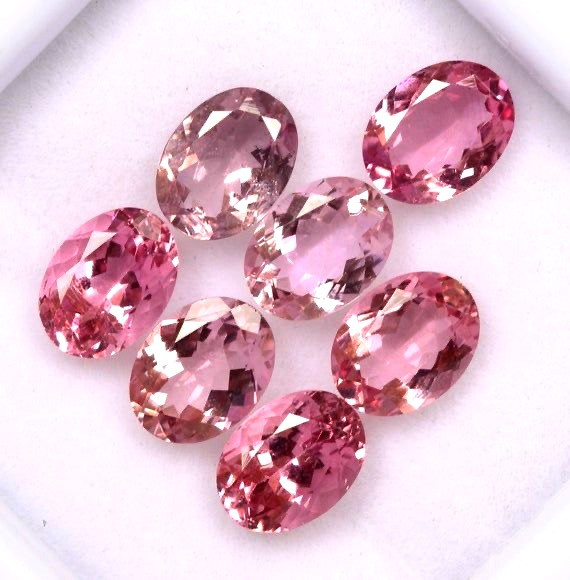 selection of loose oval pink tourmaline